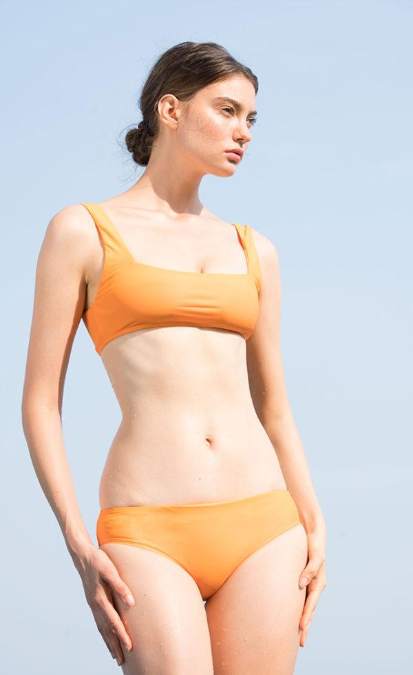 A woman with the Amber Square bikini.