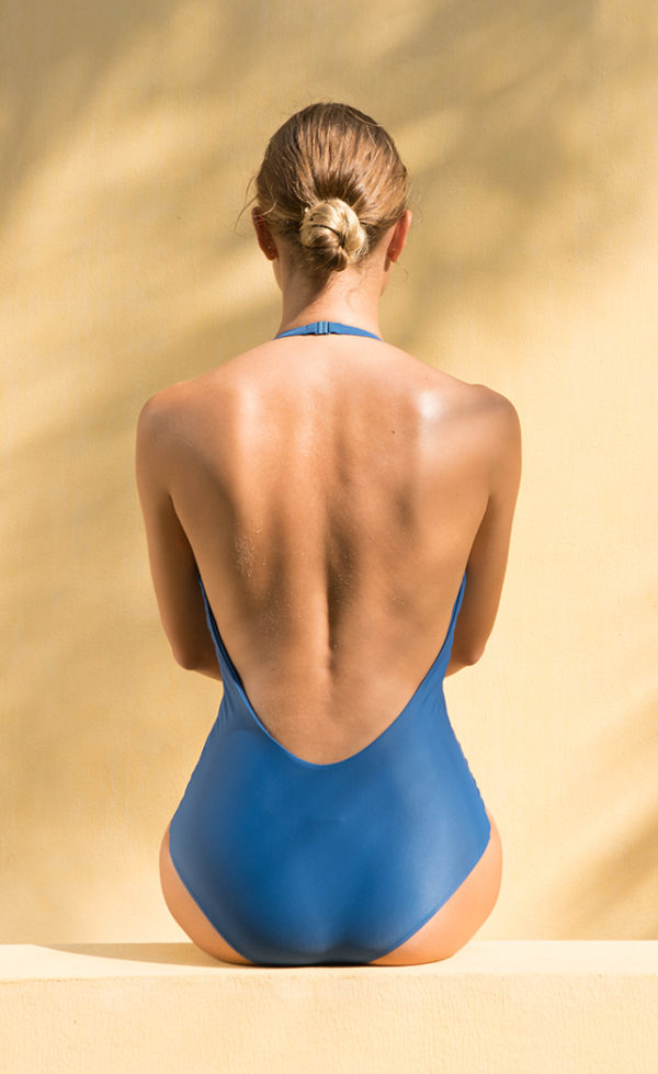 The Halter one-piece swimsuit in ocean blue color.